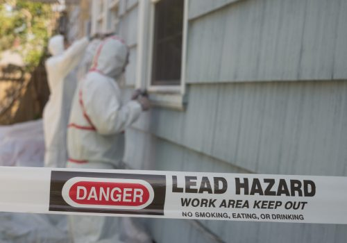 Two,House,Painters,In,Hazmat,Suits,Removing,Lead,Paint,From